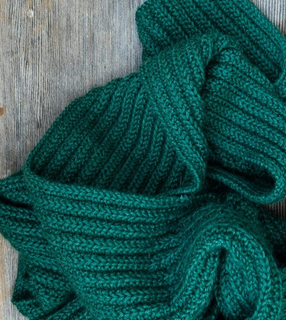 The ribbed knitting pattern creates a scarf with a lovely drape.