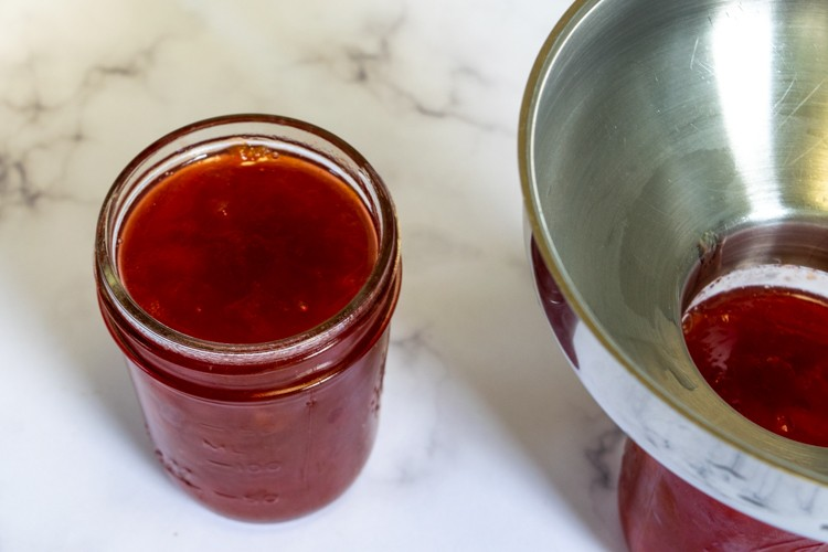 Jars filled with plum jam for canning