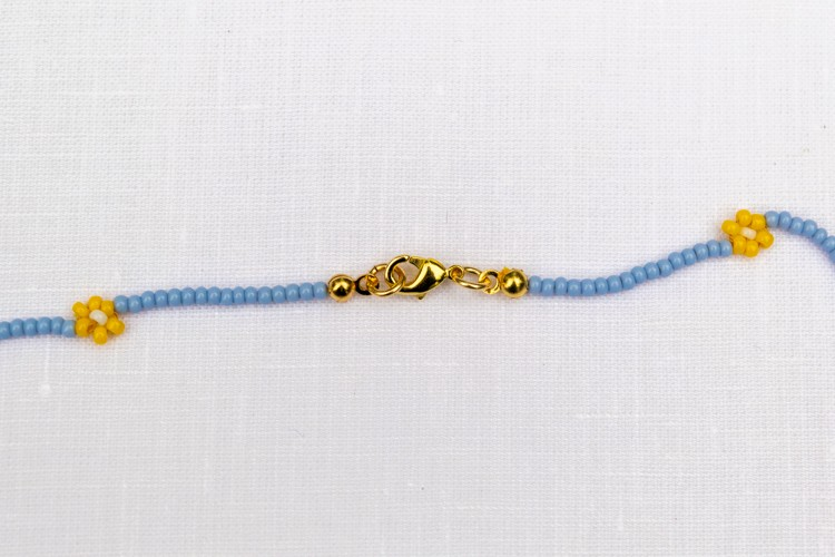 The finished clasp with crimp beads, lobster clasp, and jump rings