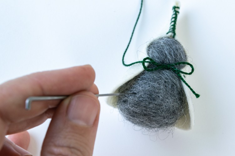 Use the felting needle to shape your gnome's body