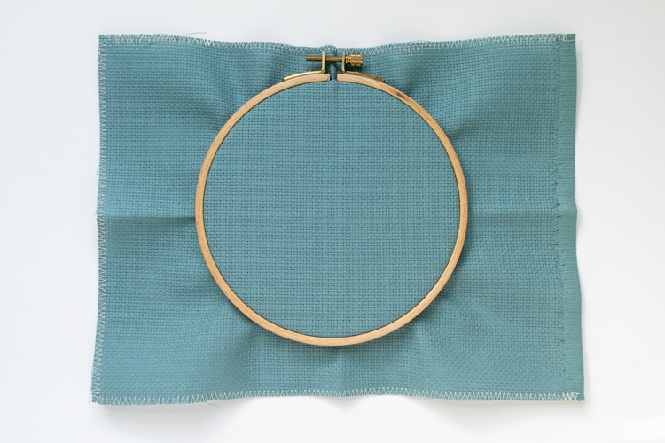 Finish the cross stitch cloth edge and fit into embroidery hoop
